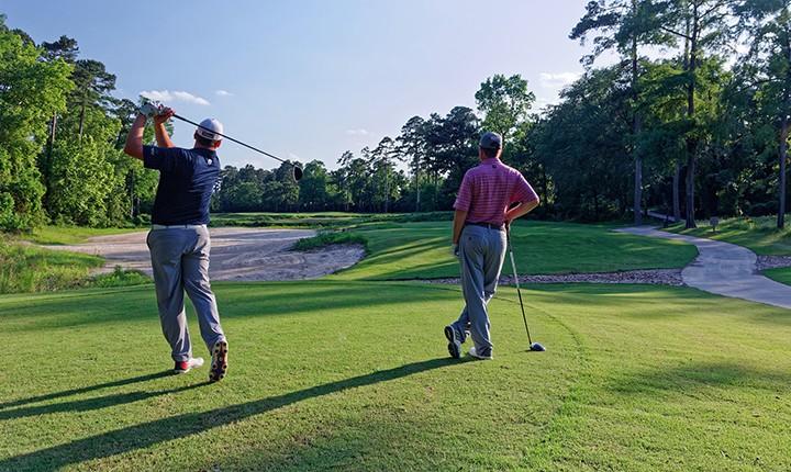 cypresswood golf club houston golf course 2 golfers teeing off
